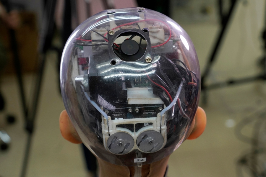 The head of Sophia shows the inside content visually through the transparent skull at Hanson Robotics studio in Hong Kong on March 29, 2021. (AP Photo/Vincent Yu)