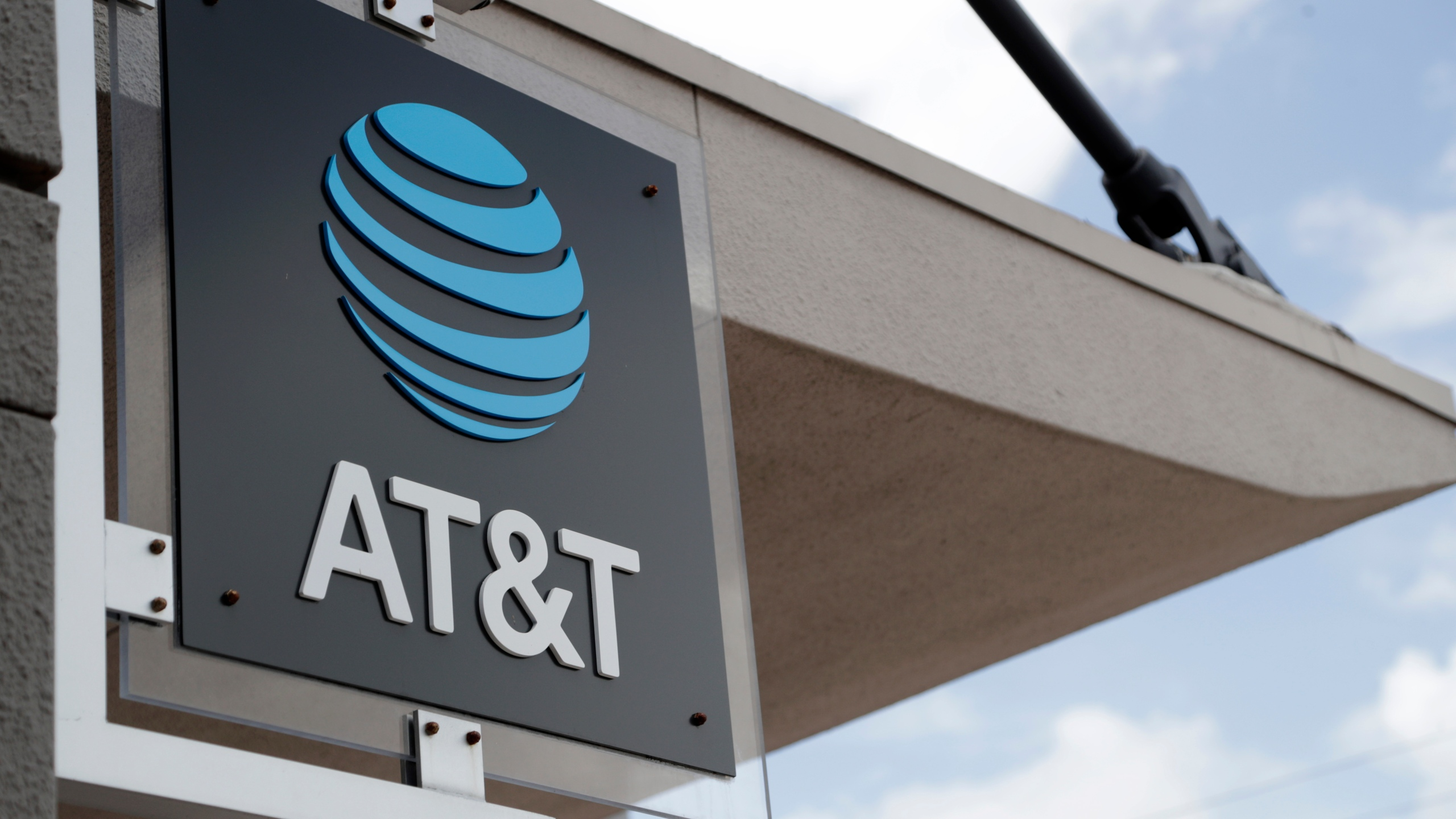 In this July 18, 2019, file photo, a sign is displayed at an AT&T retail store in Miami. (AP Photo/Lynne Sladky, File)