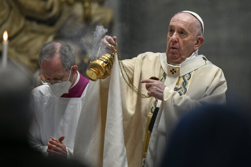 Pope Francis celebrates Easter Mass at St. Peter's Basilica at The Vatican Sunday, April 4, 2021, during the Covid-19 coronavirus pandemic. (Filippo Monteforte/Pool photo via AP)