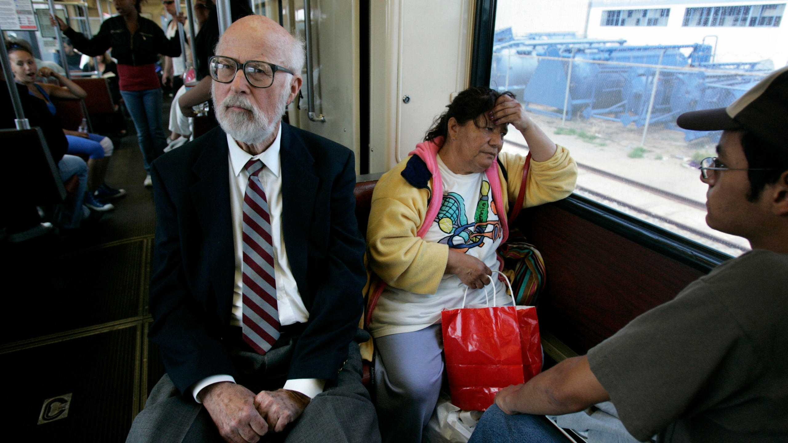 In this in May 2, 2007, photo, California state legislator James Mills, father of the San Diego Trolley, rides the Blue Line in San Diego. (Laura Embry/The San Diego Union-Tribune via AP, File)