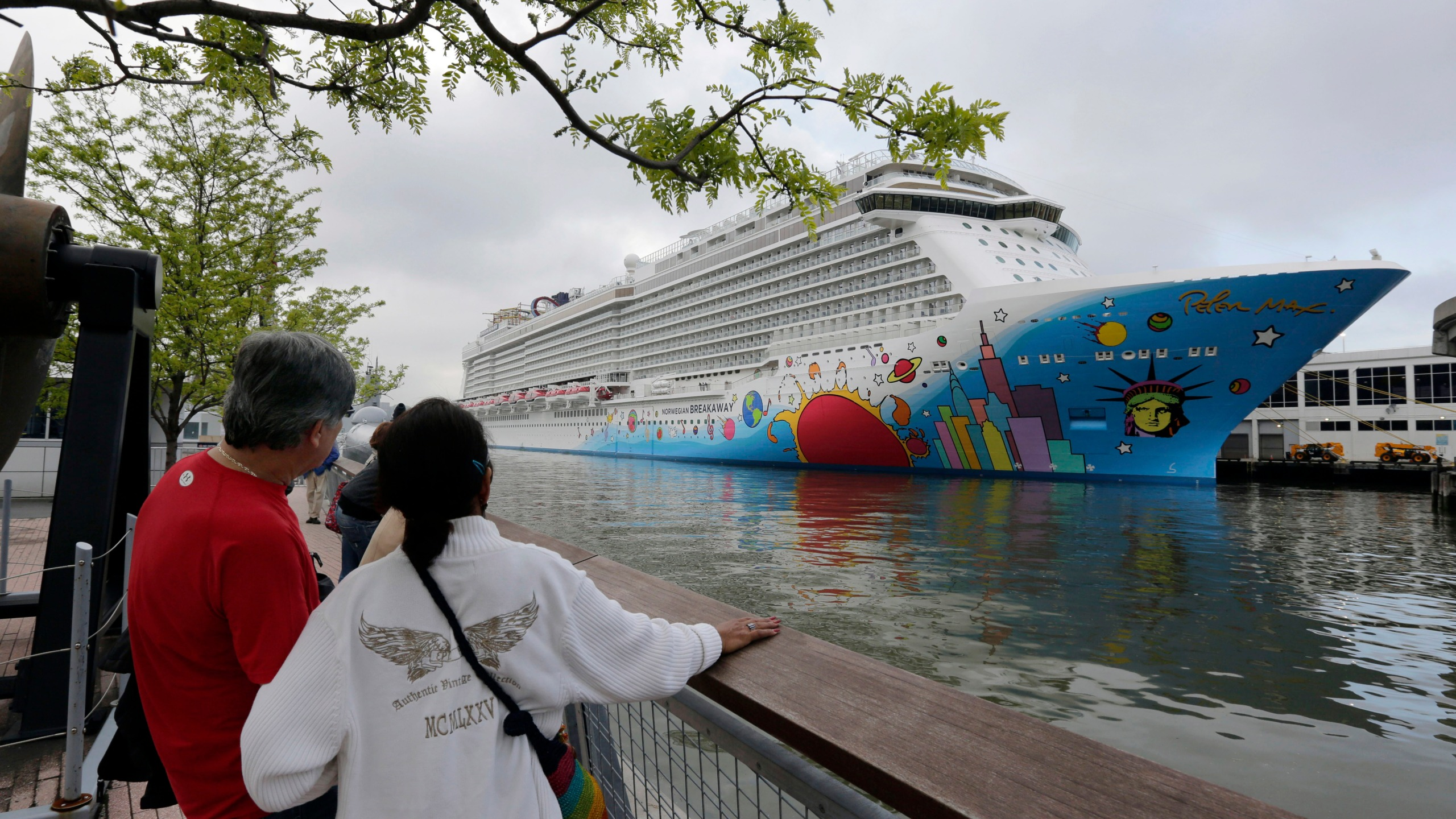 In this May 8, 2013, file photo, people pause to look at Norwegian Cruise Line's ship, Norwegian Breakaway, on the Hudson River, in New York. On Monday, April 5, 2021, Norwegian Cruise Line's parent company asked the Centers for Disease Control and Prevention for permission to resume cruises from U.S. ports on July 4 by requiring passengers and crew members to be vaccinated against COVID-19 at least two weeks before the trip. (AP Photo/Richard Drew, File)