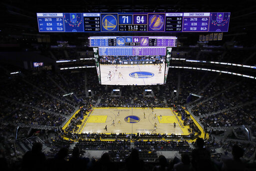 In this Oct. 5, 2019, file photo, fans watch from a general view of Chase Center during the second half of a preseason NBA basketball game between the Golden State Warriors and the Los Angeles Lakers in San Francisco. (AP Photo/Jeff Chiu, File)