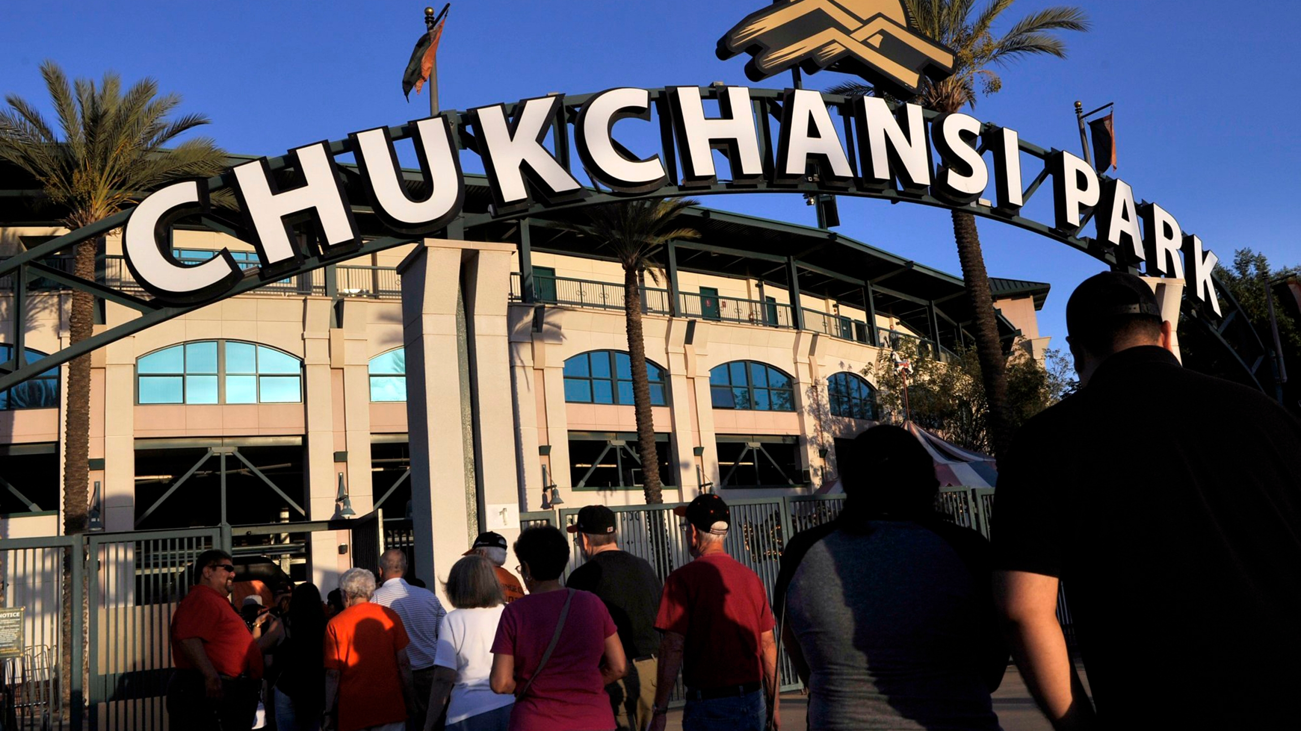 In this Sept. 18, 2015, file photo, fans arrive at Chukchansi Park in Fresno, Calif., for a minor-league baseball game between the Fresno Grizzlies and the Round Rock Express. (Eric Paul Zamora/The Fresno Bee via AP, File)