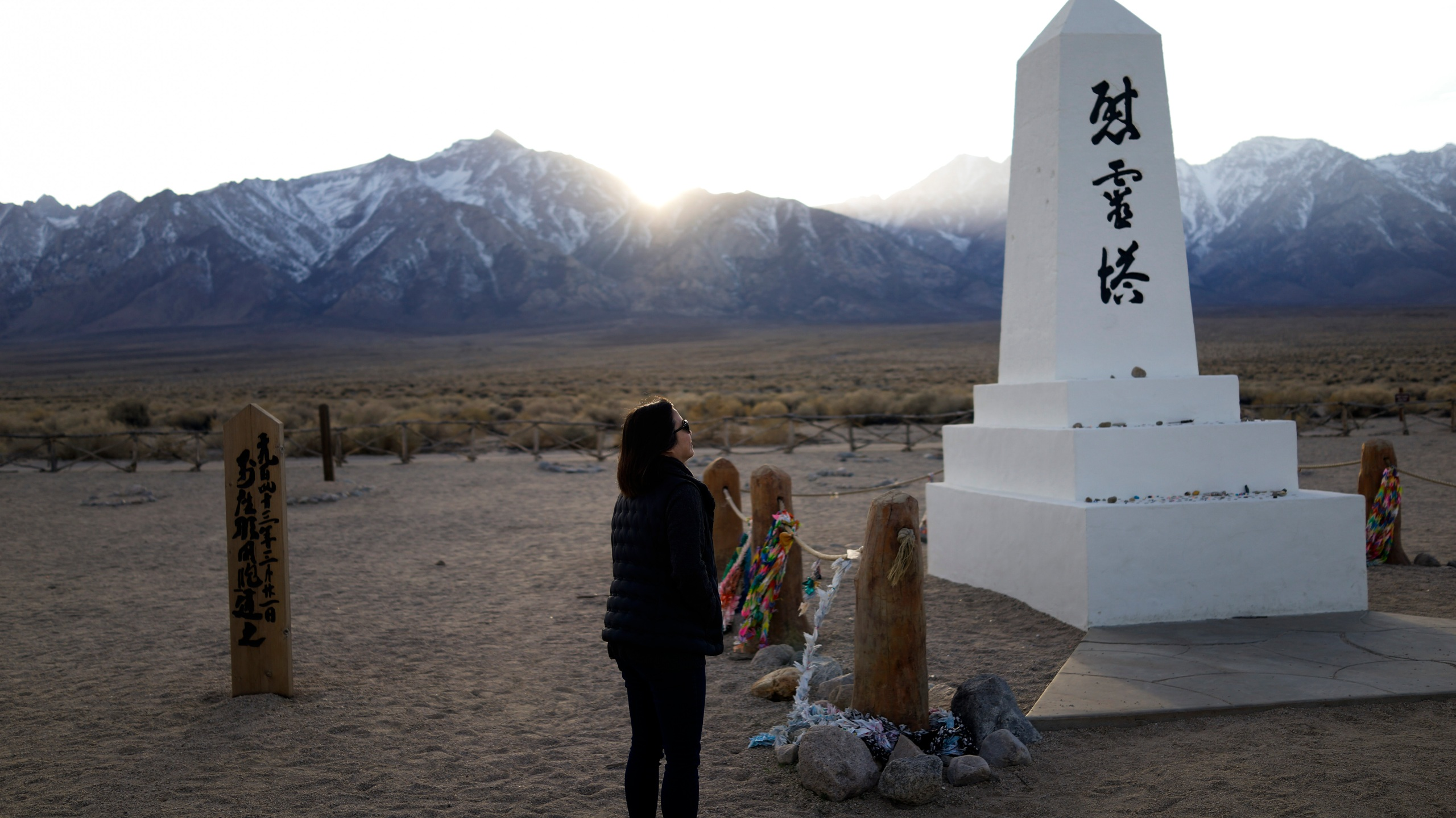 Lori Matsumura visits the cemetery at the Manzanar National Historic Site near Independence, Calif., on Feb. 17, 2020. (Brian Melley / Associated Press)