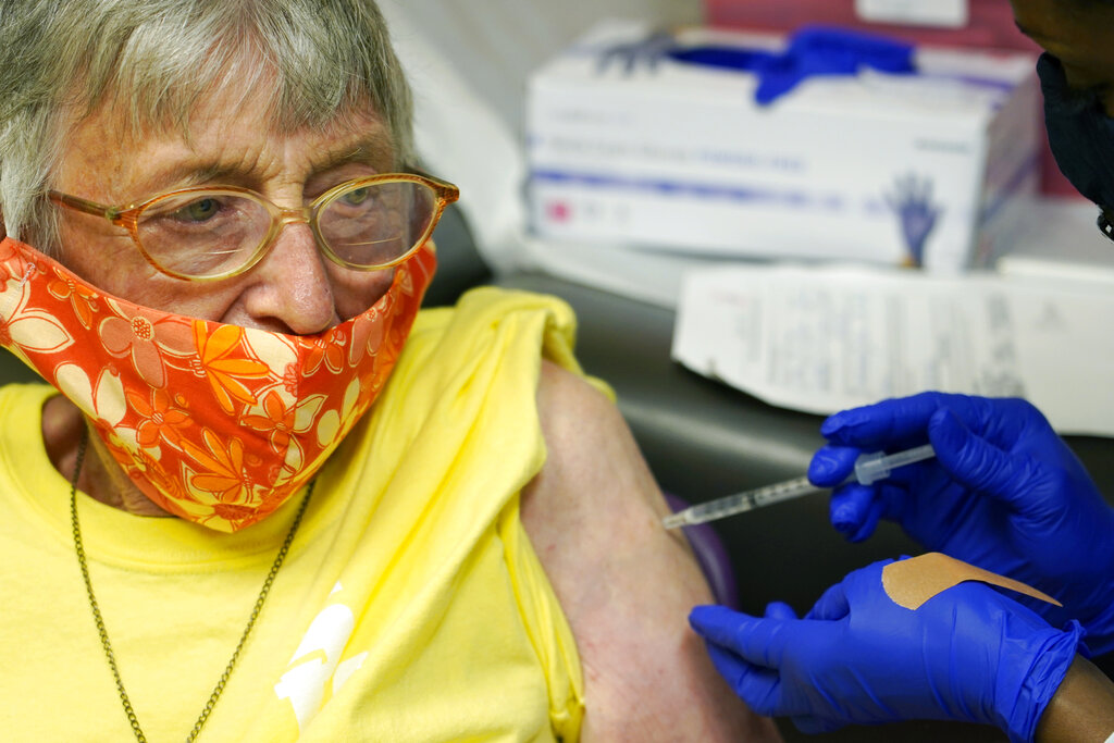 Linda Busby, 74, stiffens up as she receives the Johnson & Johnson COVID-19 vaccine at the Aaron E. Henry Community Health Service Center, Wednesday, April 7, 2021, in Clarksdale, Miss. (AP Photo/Rogelio V. Solis)