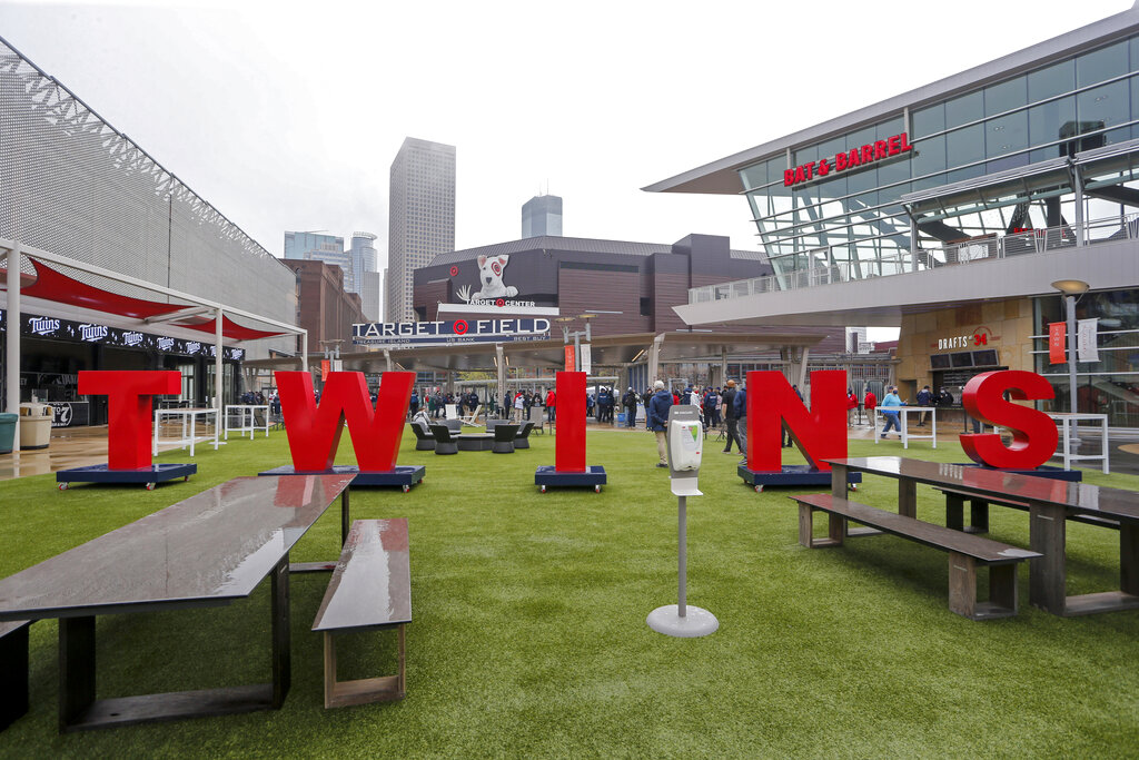 Fans enter Target Field for the Minnesota Twins home opener baseball game against the Seattle Mariners on Thursday, April 8, 2021, in Minneapolis. (AP Photo/Bruce Kluckhohn)