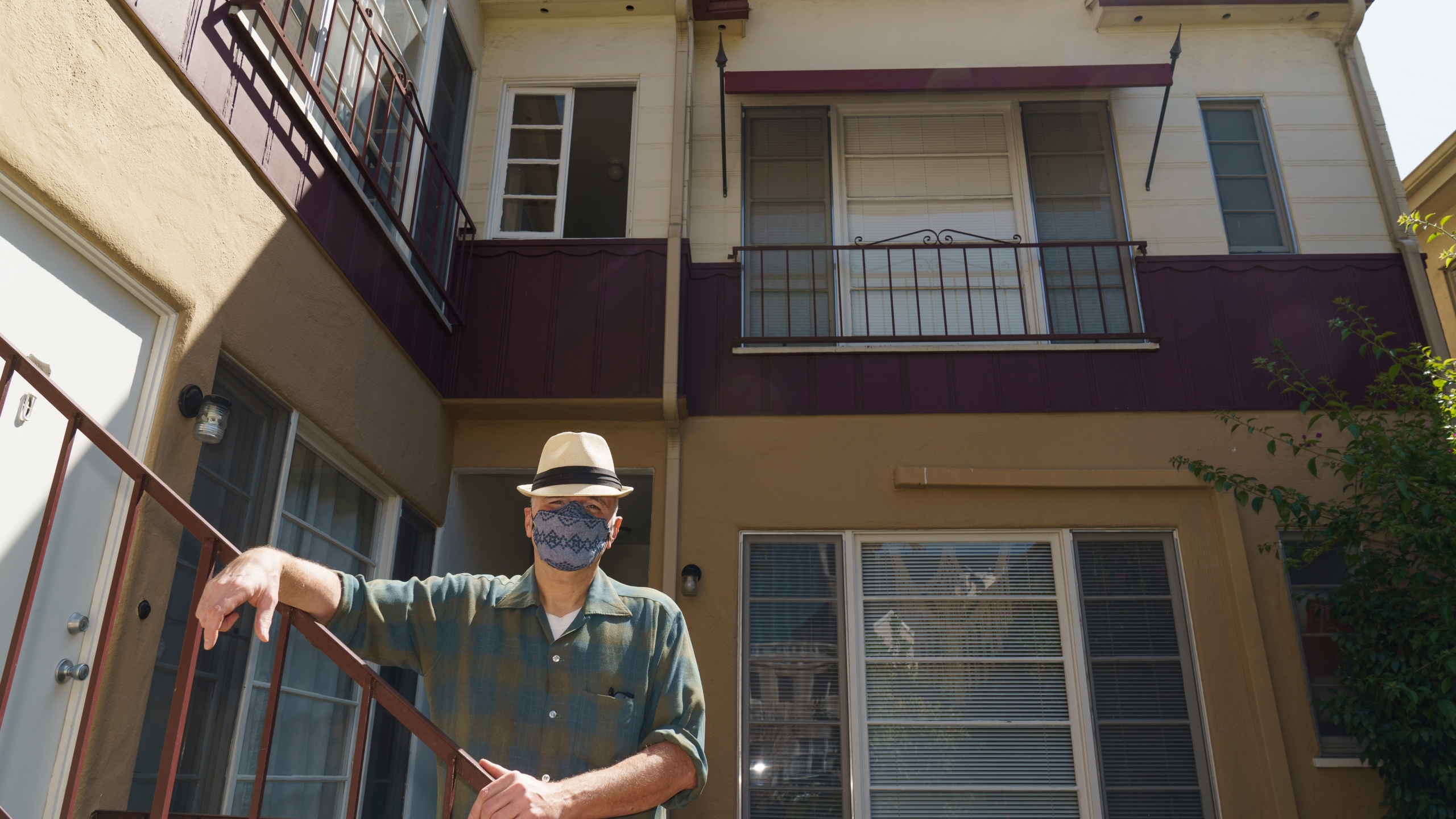 Nathan Long, a video game writer, poses for a picture outside his rental apartment courtyard in Glendale on April 8, 2021. He and his wife, Lili, have been unsuccessful so far in their search for a home in Los Angeles. (AP Photo/Damian Dovarganes)