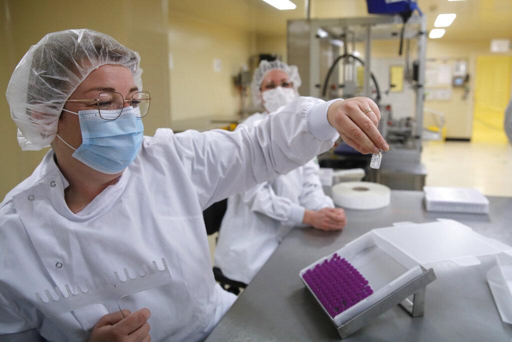Employees work at the Delpharm plant in Saint-Remy-sur-Avre, west of Paris, Friday, April 9, 2021 in Paris. (AP Photo/Christophe Ena, Pool)