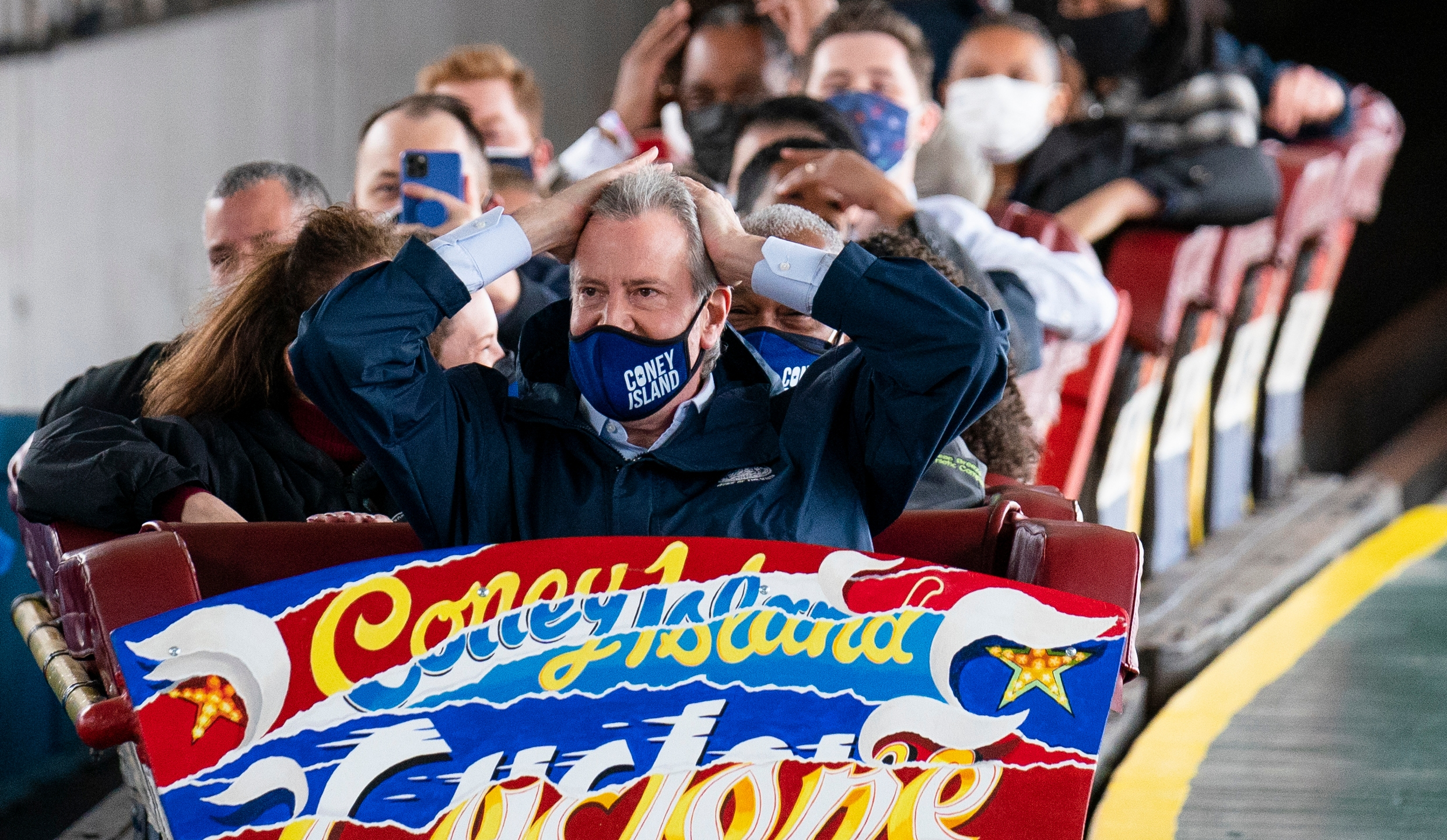 New York City Mayor Bill de Blasio finishes a ride on the Cyclone rollercoaster after attending the ribbon cutting and seasonal opening of the Coney Island amusement park area on April 9, 2021, in the Brooklyn borough of New York. (John Minchillo / Associated Press)