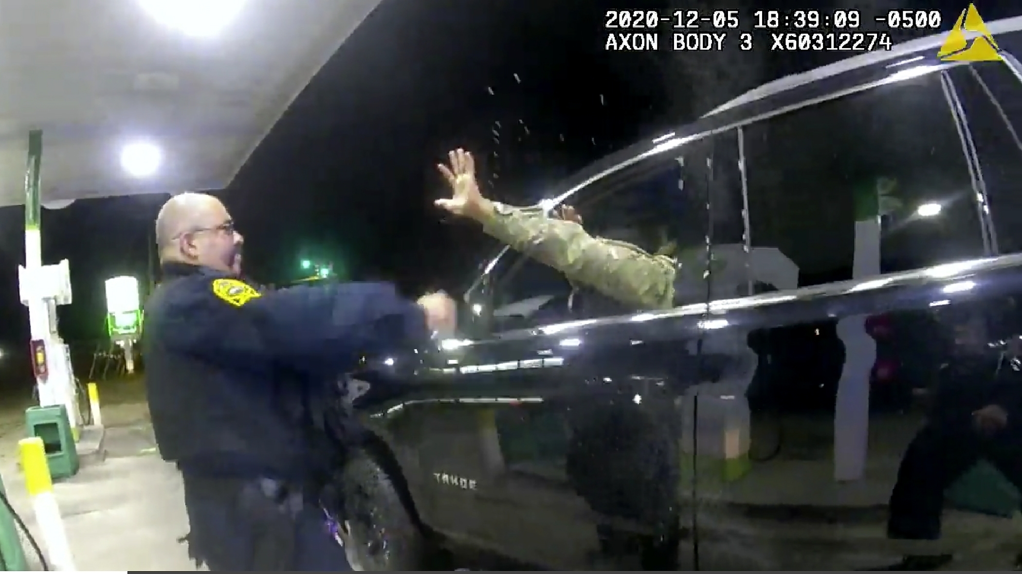 In this image made from Windsor, (Va.) Police video, A police officer uses a spray agent on Caron Nazario on Dec. 20, 2020, in Windsor, Va. (Windsor Police via AP)