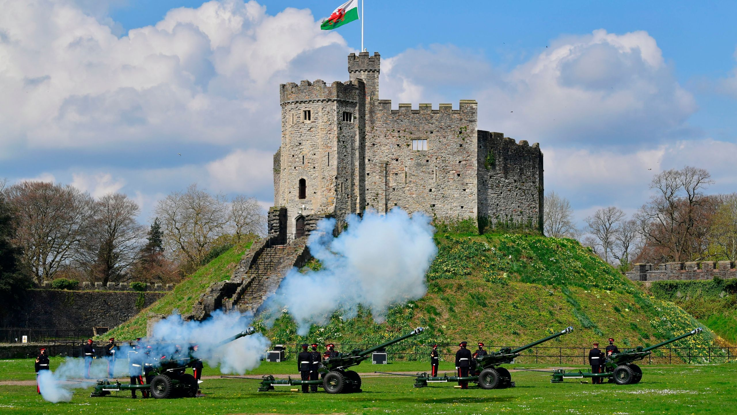 Members of the 104th Regiment Royal Artillery fire a 41-round gun salute in the grounds of Cardiff Castle, to mark the death of Prince Philip, in Cardiff, Saturday, April 10, 2021. (Ben Birchall/PA via AP)