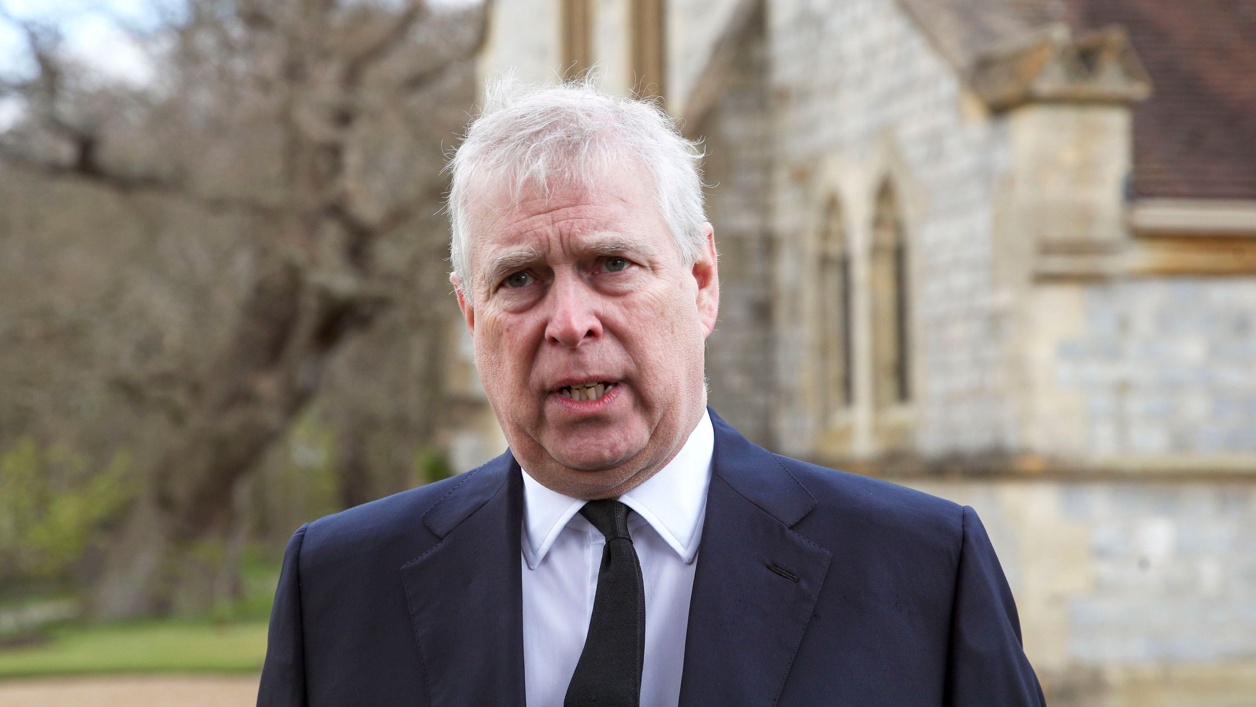 Britain's Prince Andrew during a television interview at the Royal Chapel of All Saints at Royal Lodge, Windsor, following the announcement of Prince Philip, in England, Sunday, April 11, 2021. (Steve Parsons/Pool Photo via AP)