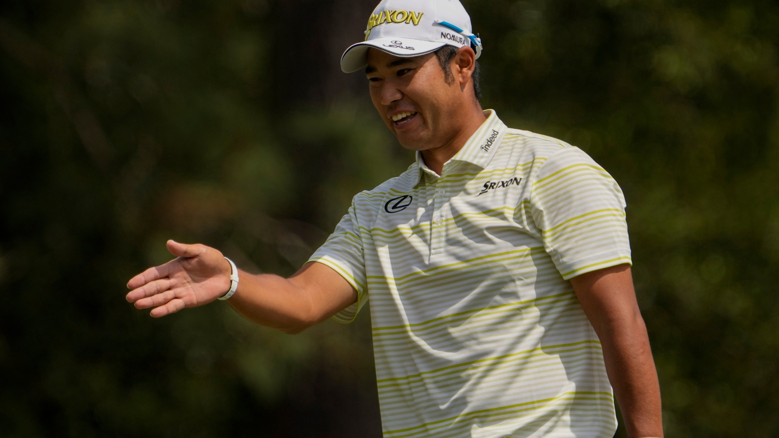 Hideki Matsuyama, of Japan, reacts after a bogey on the first hole during the final round of the Masters golf tournament on Sunday, April 11, 2021, in Augusta, Ga. (AP Photo/David J. Phillip)