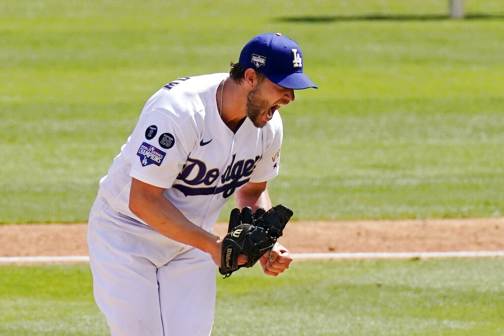 Los Angeles Dodgers starting pitcher Clayton Kershaw celebrates after striking out Washington Nationals' Jordy Mercer to end the top of the sixth inning of a baseball game Sunday, April 11, 2021, in Los Angeles. (AP Photo/Mark J. Terrill)