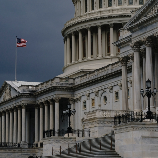 In this Aug. 3, 2020, file photo dark clouds and heavy rain sweep over the U.S. Capitol in Washington. The U.S. government's budget deficit surged to an all-time high of $1.7 trillion for the first six months of this budget year, nearly double the previous record, as another round of economic-support checks added billions of dollars to spending last month. (AP Photo/J. Scott Applewhite, File)