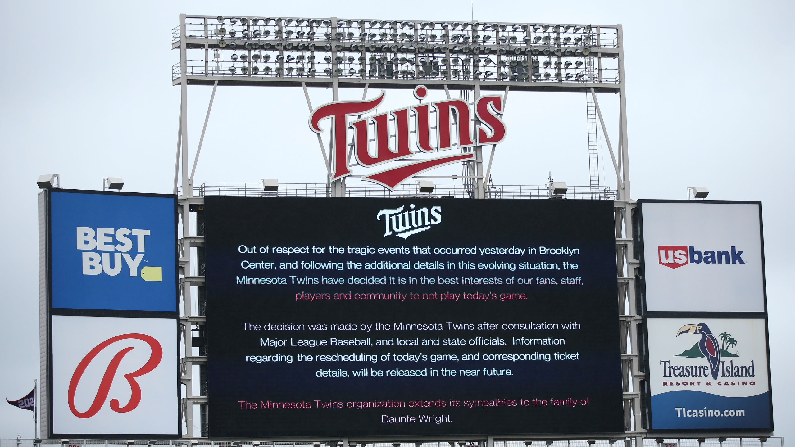 The scoreboard at Target Field explains the postponement of the baseball game between the Minnesota Twins and Boston Red Sox in Minneapolis on April 12, 2021. (Stacy Bengs / Associated Press)