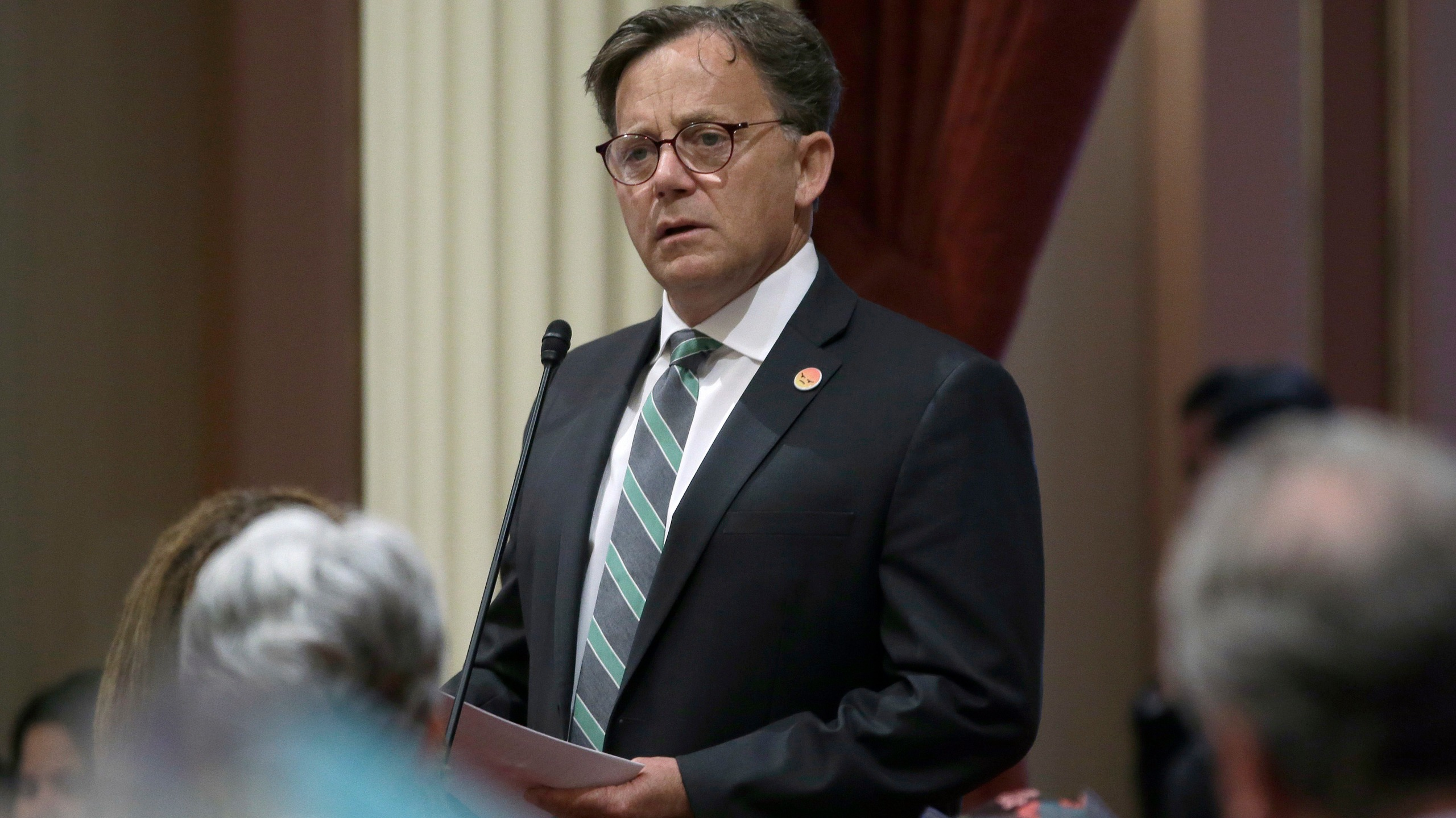 In this June 11, 2018, file photo, state Sen. Josh Newman, D-Fullerton, discusses the recall election against him, during a Senate session in Sacramento, Calif. Newman was recalled in 2018 before winning re-election in 2020. He presented new legislation on Monday, April 12, 2021, that would allow politicians facing recalls to see who signs the petitions against them. (AP Photo/Rich Pedroncelli, File)