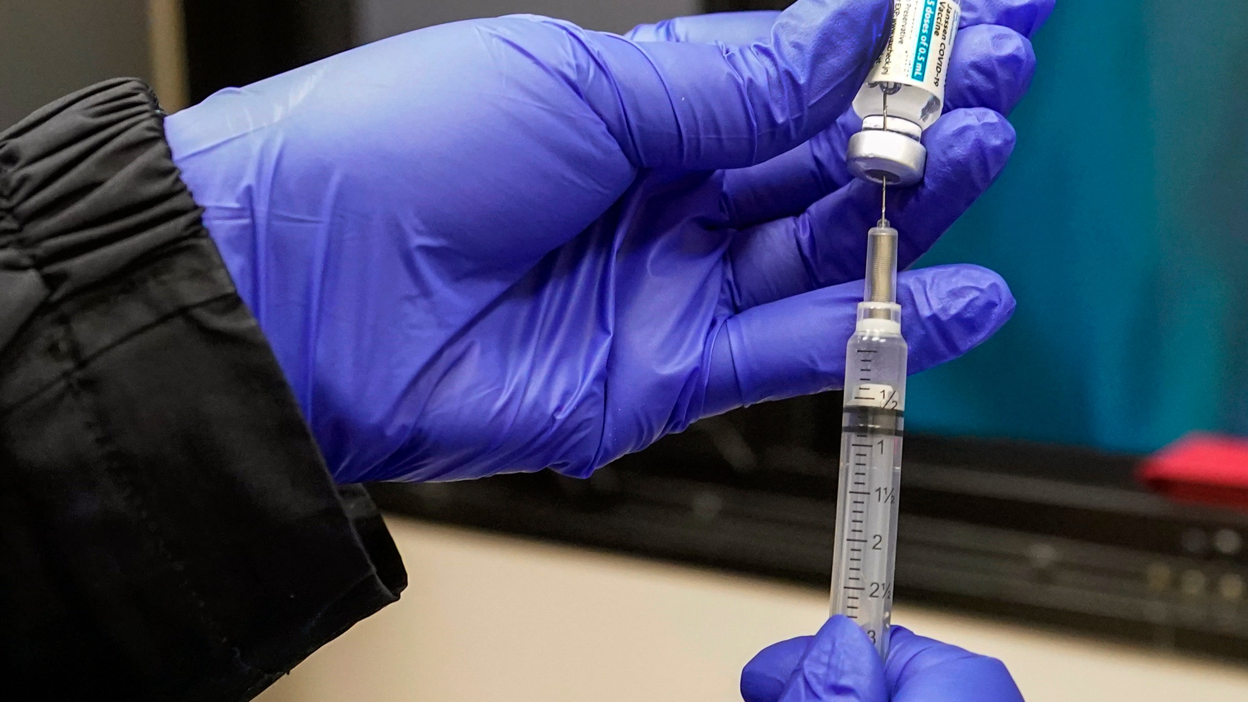 "In this March 31, 2021, file photo, a nurse fills a syringe with Johnson & Johnson's one-dose COVID-19 vaccine at the Vaxmobile, at the Uniondale Hempstead Senior Center, in Uniondale, N.Y. U.S. health regulators on Tuesday, April 13, is recommending a ""pause"" in using the vaccine to investigate reports of potentially dangerous blood clots. (AP Photo/Mary Altaffer, File)"