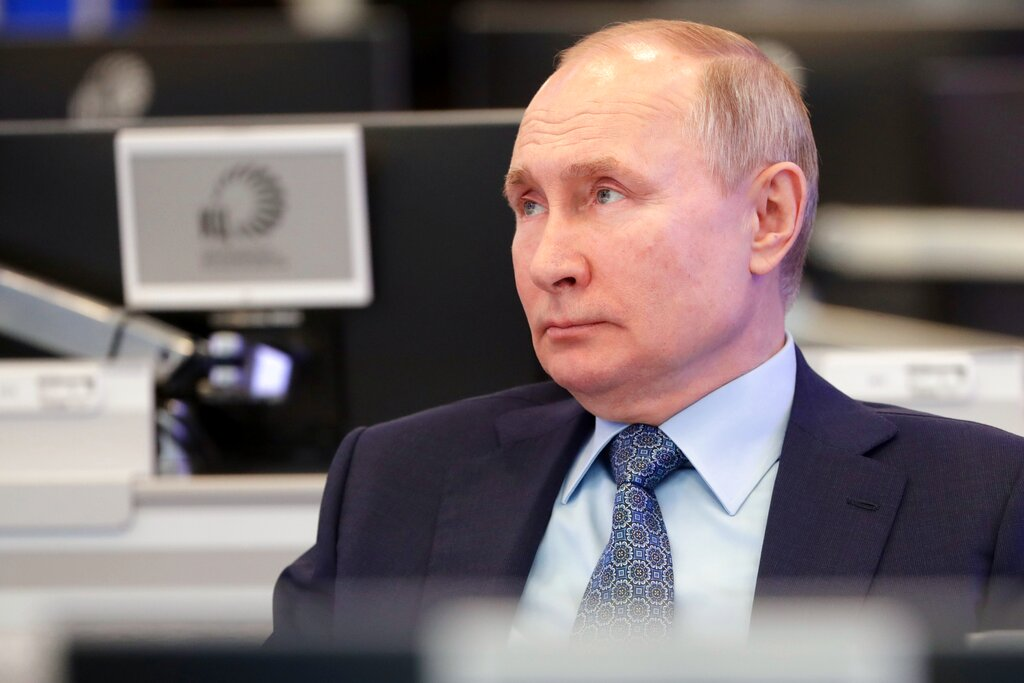 Russian President Vladimir Putin visits the Coordination Center of the Russian Government in Moscow, Russia, Tuesday, April 13, 2021. (Mikhail Metzel, Sputnik, Kremlin Pool Photo via AP)