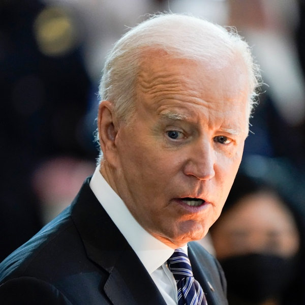 """President Joe Biden speaks during a ceremony to honor slain U.S. Capitol Police officer William """"Billy"""" Evans as he lies in honor at the Capitol in Washington on April 13, 2021. (J. Scott Applewhite / Associated Press)"""