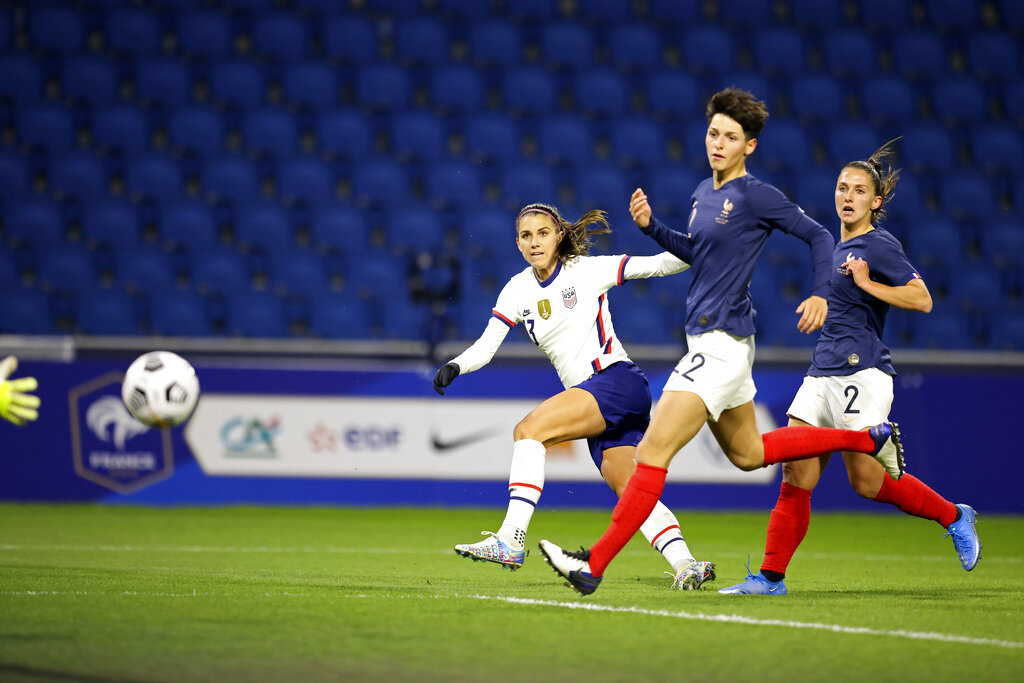 United States' Alex Morgan (13) scores a goal against France during an international friendly women's soccer match between the United States and France in Le Havre, France, Tuesday, April 13, 2021. (AP Photo/David Vincent)