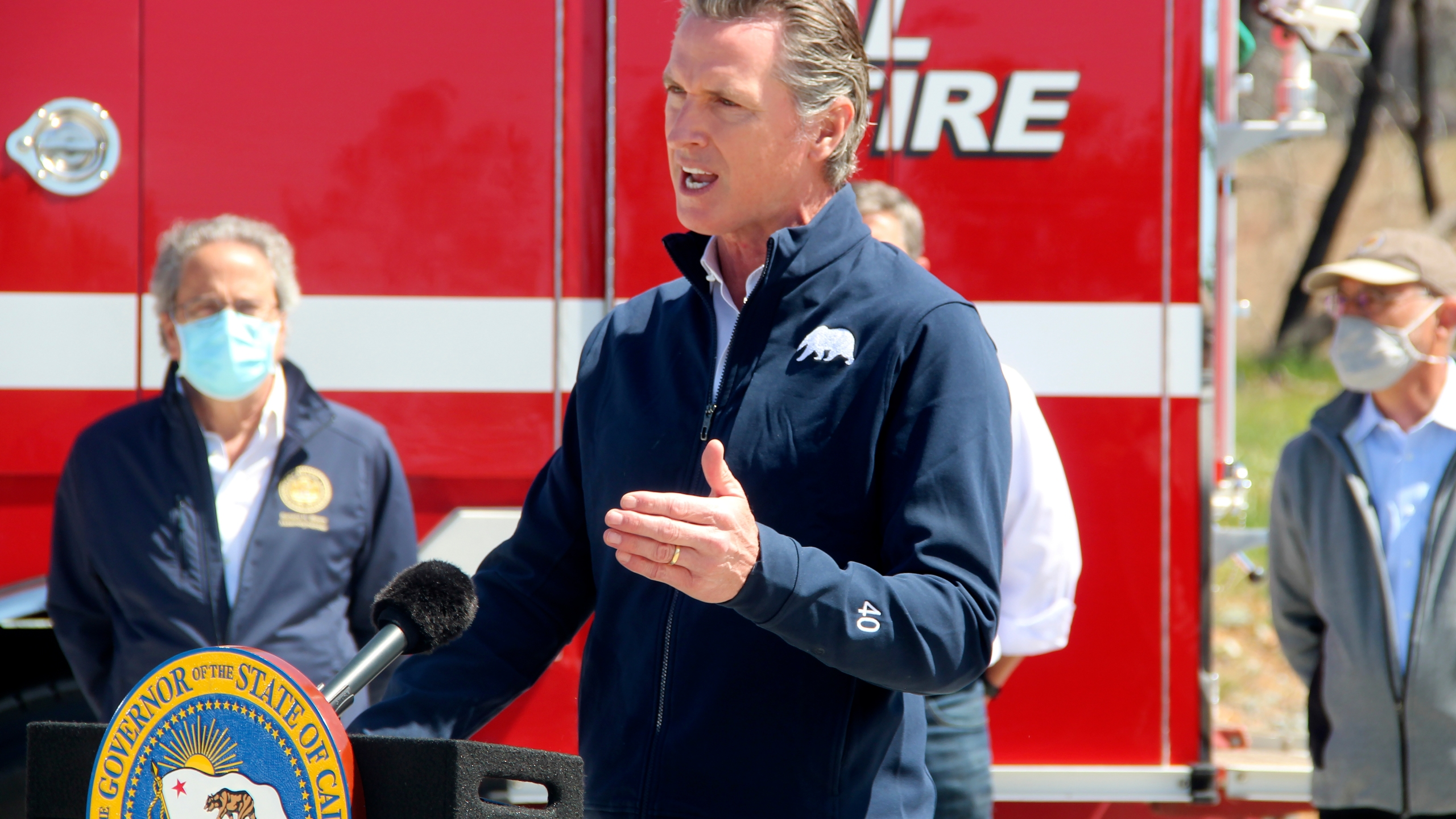 California Gov. Gavin Newsom is seen after signing the legislation into law that authorizes more than half a billion in new spending to prepare for wildfire season on April 13, 2021, at the Loafer Creek State Recreation Area in Oroville, Calif. (Adam Beam / Associated Press)