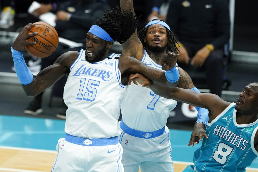Los Angeles Lakers center Montrezl Harrell pulls a rebound away from Charlotte Hornets center Bismack Biyombo during the second half in an NBA basketball game on Tuesday, April 13, 2021, in Charlotte, N.C. (AP Photo/Chris Carlson)
