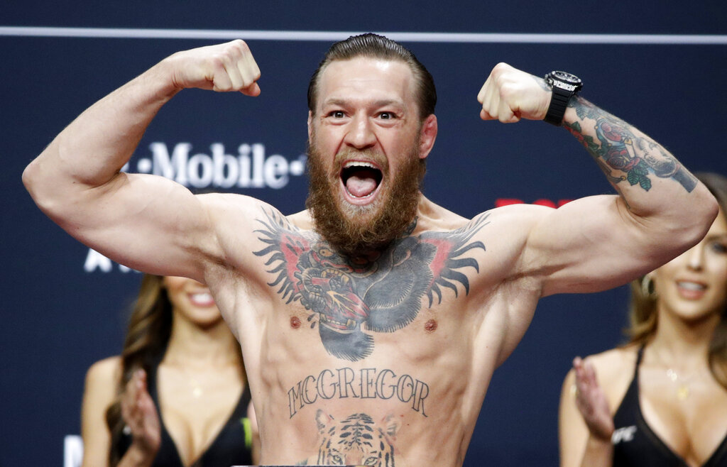 Conor McGregor poses during a ceremonial weigh-in for the UFC 246 mixed martial arts bout in Las Vegas, in this Friday, Jan. 17, 2020, file photo. (AP Photo/John Locher, File)