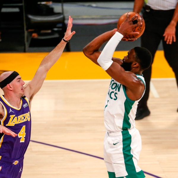 Boston Celtics' Jaylen Brown shoots over Los Angeles Lakers' Alex Caruso (4) during the first half of an NBA basketball game in Los Angeles on April 15, 2021. (Ringo H.W. Chiu / Associated Press)