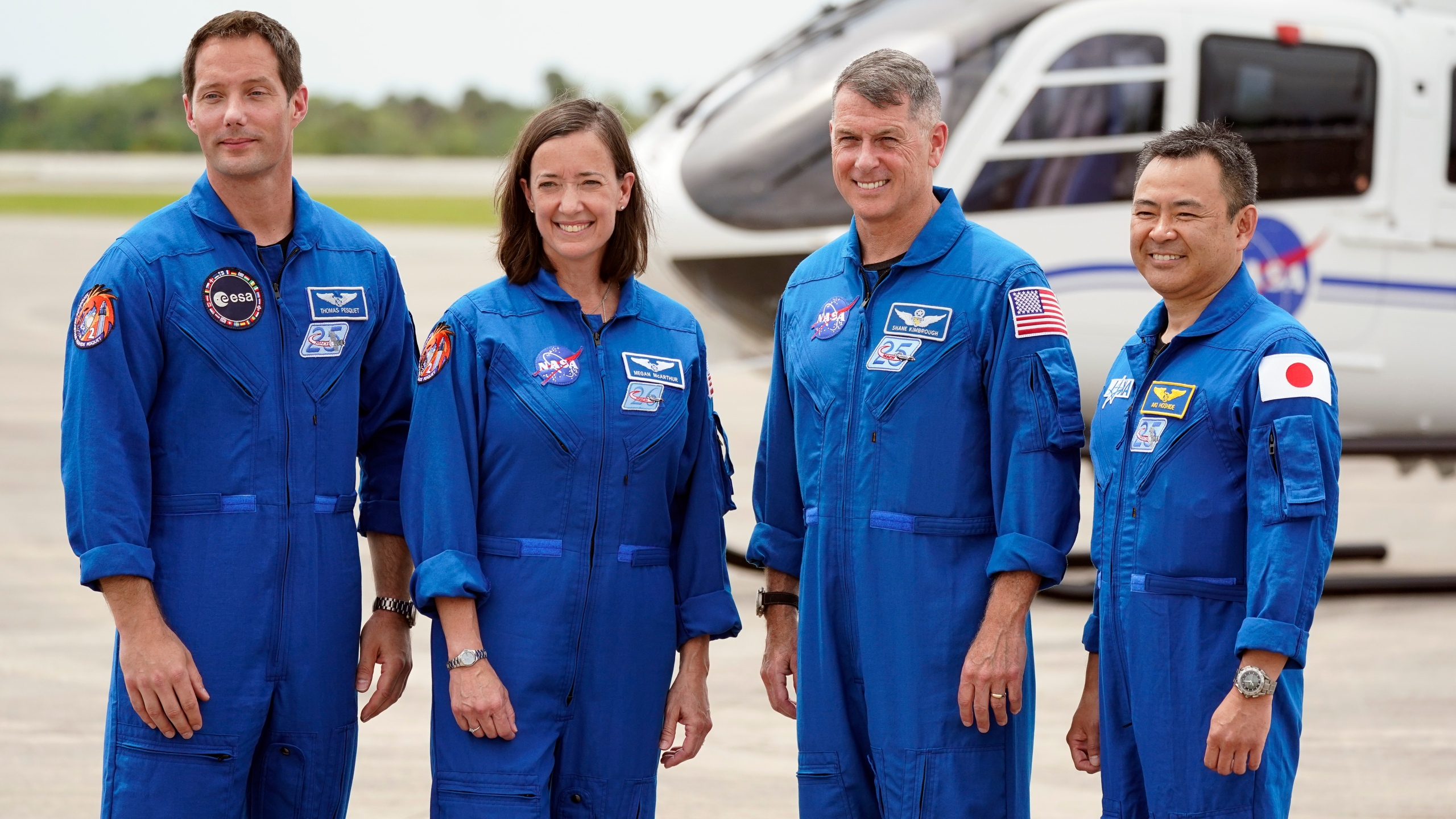 SpaceX Crew 2 members, from left, European Space Agency astronaut Thomas Pesquet, NASA astronauts Megan McArthur and Shane Kimbrough and Japan Aerospace Exploration Agency astronaut Akihiko Hoshide gather at the Kennedy Space Center in Cape Canaveral, Florida, Friday, April 16, 2021 to prepare for a mission to the International Space Station. The launch is targeted for April 22. (AP Photo/John Raoux)