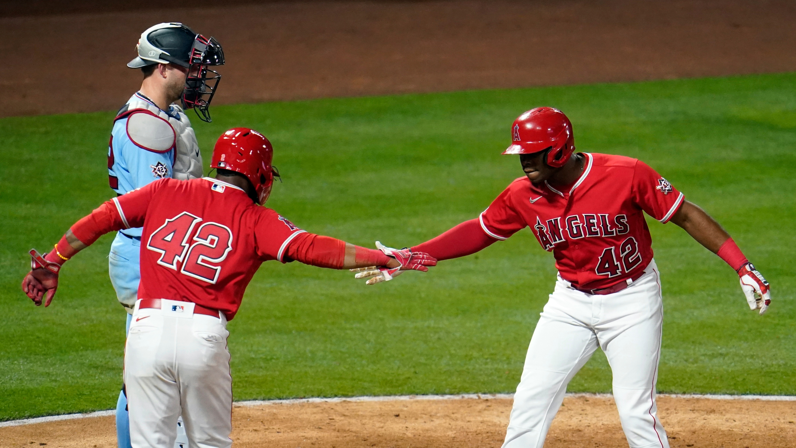 Los Angeles Angels' Justin Upton, right, celebrates his grand slam at home plate with Luis Rengifo during the seventh inning of a baseball game against the Minnesota Twins in Anaheim on April 16, 2021. (Marcio Jose Sanchez / Associated Press)