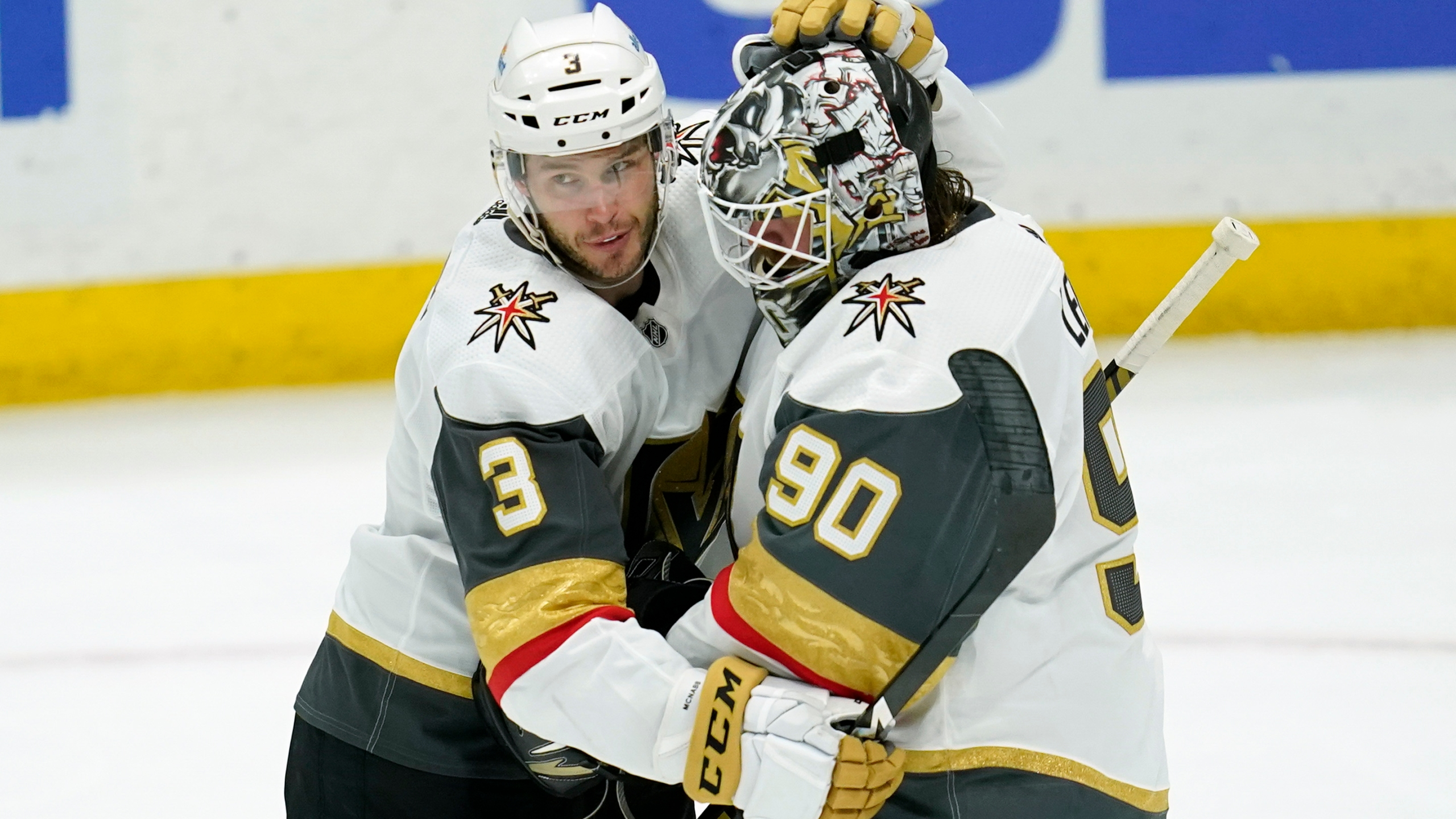 Vegas Golden Knights defenseman Brayden McNabb (3) and goaltender Robin Lehner (90) celebrate a 4-0 win over the Anaheim Ducks after their NHL hockey game in Anaheim on April 16, 2021. (Ashley Landis / Associated Press)