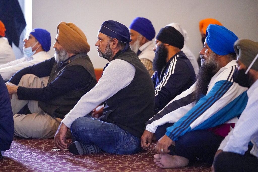 Members of the Sikh Coalition gather at the Sikh Satsang of Indianapolis in Indianapolis, Saturday, April 17, 2021 to formulate the groups response to the shooting at a FedEx facility in Indianapolis that claimed the lives of four members of the Sikh community. (AP Photo/Michael Conroy)