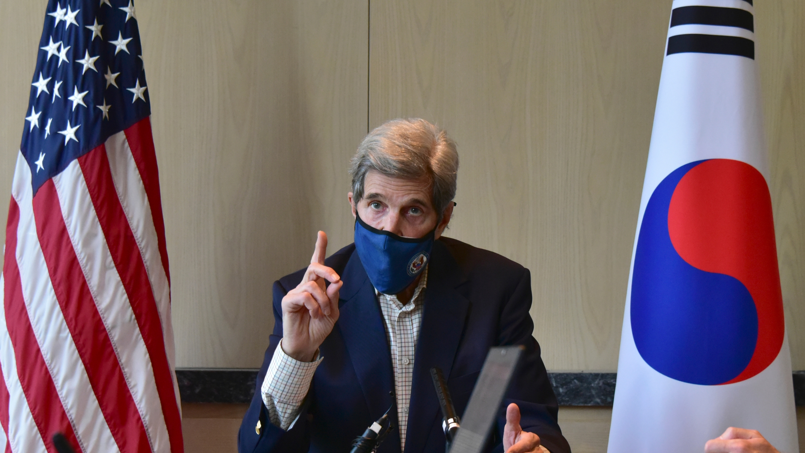 In this photo provided by U.S. Embassy Seoul, U.S. special envoy for climate John Kerry speaks during a round table meeting with the media in Seoul, South Korea, Sunday, April 18, 2021. (U.S. Embassy Seoul via AP)