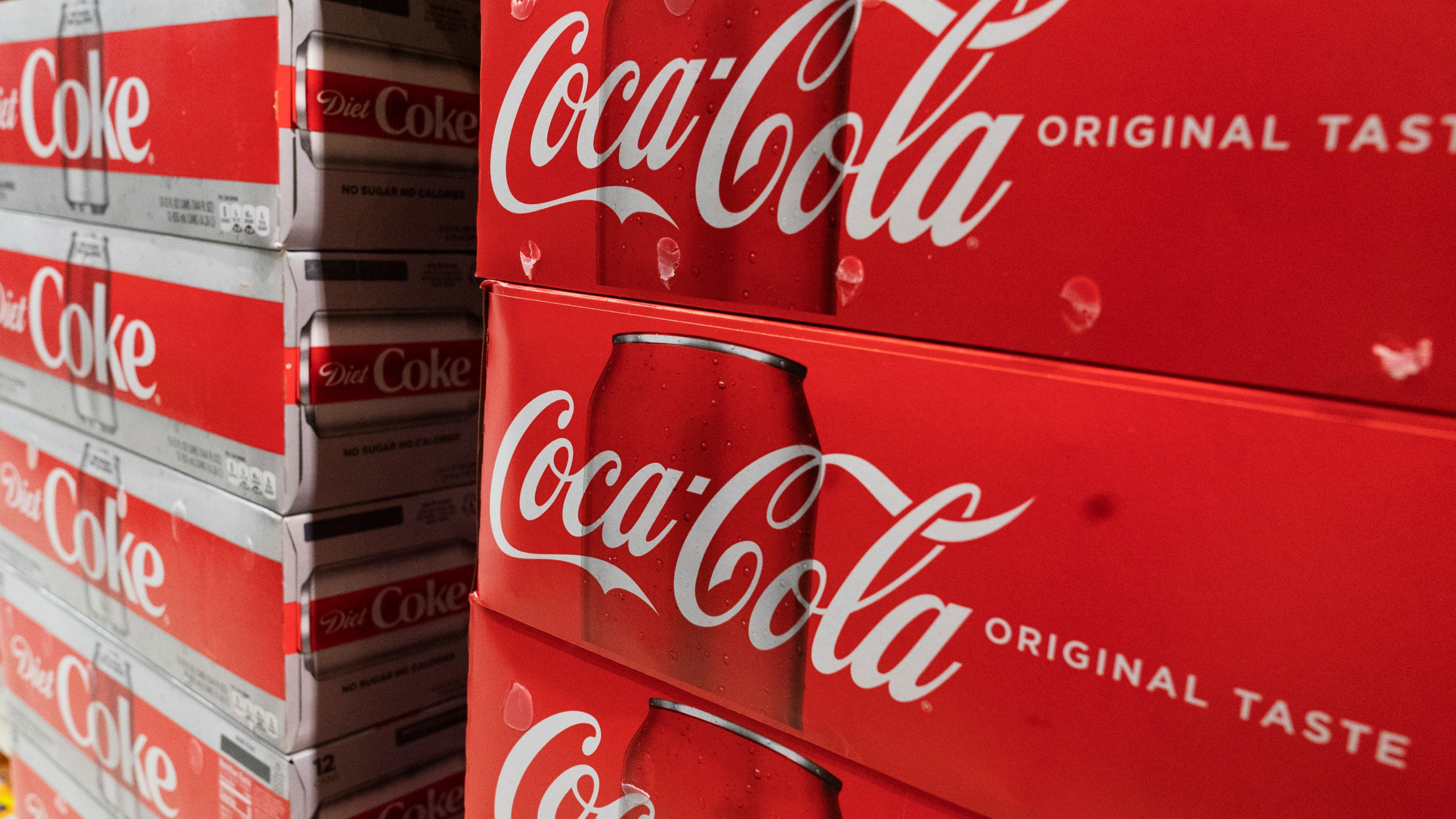 In this Monday, April 5, 2021 file photo, cases of Coca-Cola are displayed in a supermarket, in New York. Coca-Cola Co. (AP Photo/Mark Lennihan, File)