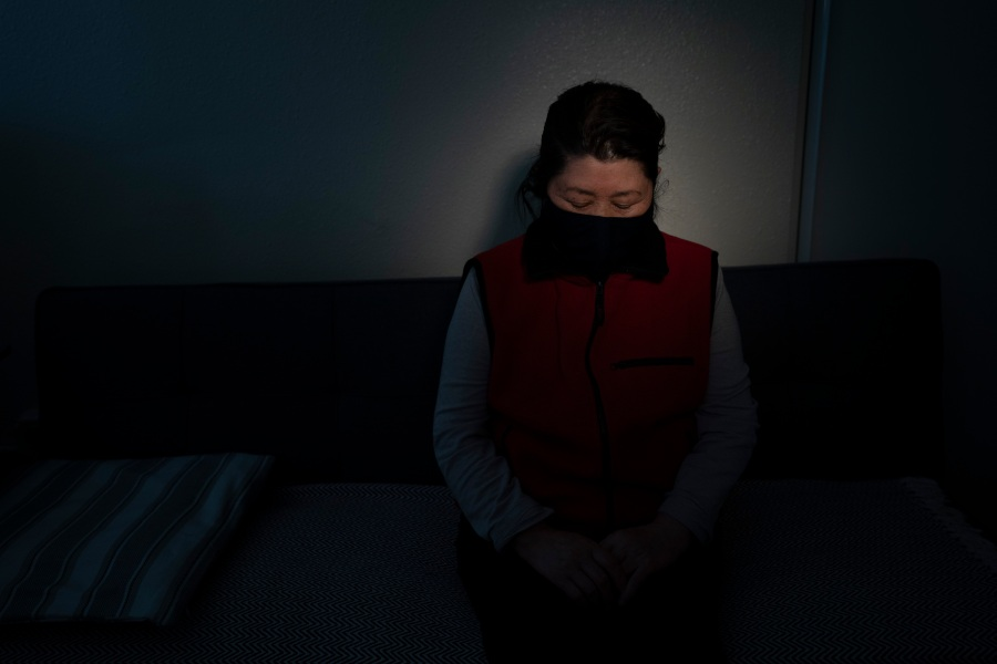 """Myung Sun Lee, a 72-year-old South Korean immigrant, pauses for photos in her apartment in the Koreatown neighborhood of Los Angeles on March 24, 2021. Lee and her husband still walk to a nearby park to exercise every morning, but they no longer take a shortcut because it doesn't feel safe. She prefers a busier street with more foot traffic. """"It terrifies me and saddens me that these hate crimes are targeting Asians,"""" said Lee. """"We already went through enough during the pandemic."""" (Jae C. Hong / Associated Press)"""