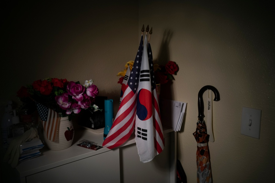 American and South Korean flags are seen in the apartment of Keum Rye Sim, an 80-year-old immigrant from South Korea, in the Koreatown neighborhood of Los Angeles on March 24, 2021. Amid a surge of anti-Asian violence, fear creeps up and alters the daily life of vulnerable Asian seniors. Sim said she is not worried too much because she doesn't leave her apartment these days. She rarely meets with people outside, except for her occasional doctor's appointments. Her concerned son accompanies her to the doctor's office. (Jae C. Hong / Associated Press)