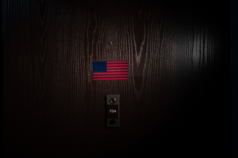 An America flag sticker is posted on the door of Hyang Ran Kim's apartment in downtown Los Angeles on March 25, 2021. The 74-year-old immigrant from South Korea temporarily moved into her daughter's place in a quiet neighborhood in the suburbs of Orange County. Kim said her daughter was too worried about her safety amid the surge in anti-Asian hate crimes. (Jae C. Hong / Associated Press)