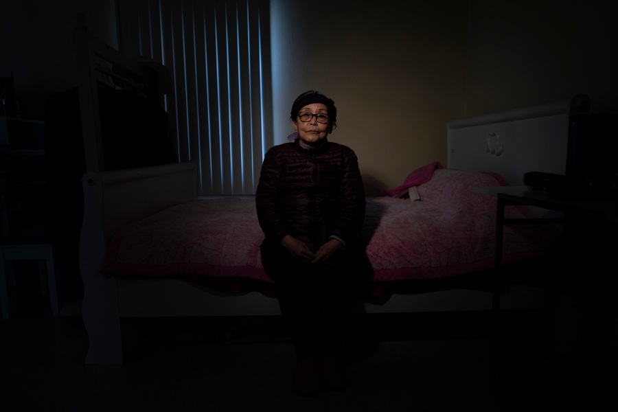 Keum Rye Sim, an 80-year-old immigrant from South Korea, pauses for photos in her apartment in the Koreatown neighborhood of Los Angeles on March 24, 2021. Amid a surge of anti-Asian violence, fear creeps up and alters the daily life of vulnerable Asian seniors. Sim said she is not worried too much because she doesn't leave her apartment these days. She rarely meets with people outside, except for her occasional doctor's appointments. Her concerned son accompanies her to the doctor's office. (Jae C. Hong / Associated Press)
