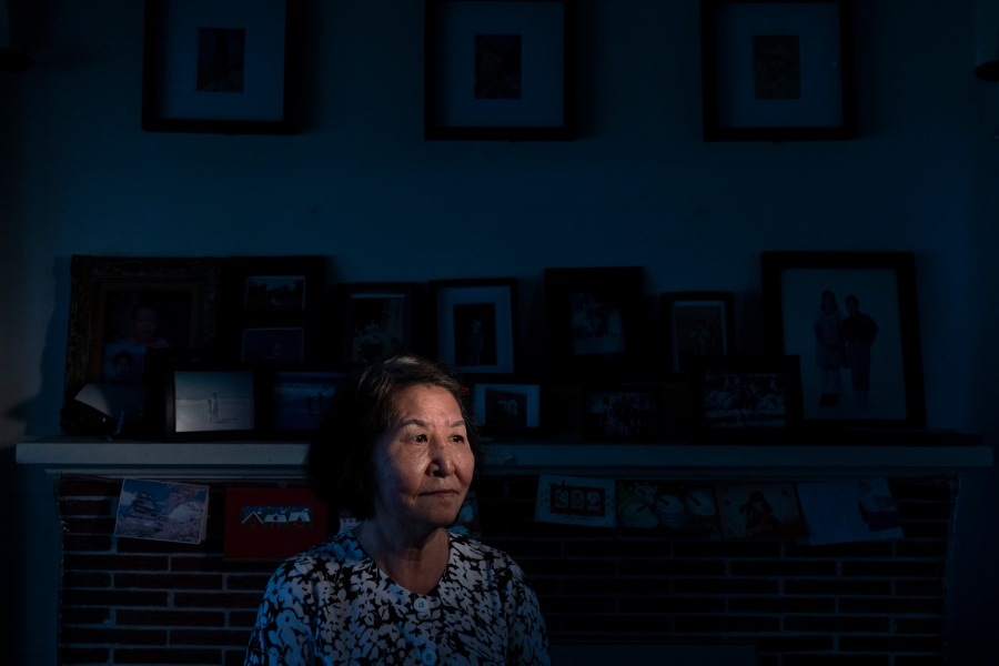 "South Korean immigrant Sung Hee Chae, 74, pauses for photos in her home in the Koreatown neighborhood of Los Angeles on March 29, 2021. For Chae, it's about a 6-minute walk to the nearest Korean grocery market. She said she doesn't go there alone anymore. Her son accompanies her to the market these days. Her daughter in South Korea also urges her not to go out at all. ""I wish all of us could get along fine regardless of the color of skin. I feel sad. I have mistreated no one,"" Chae said. (Jae C. Hong / Associated Press)"