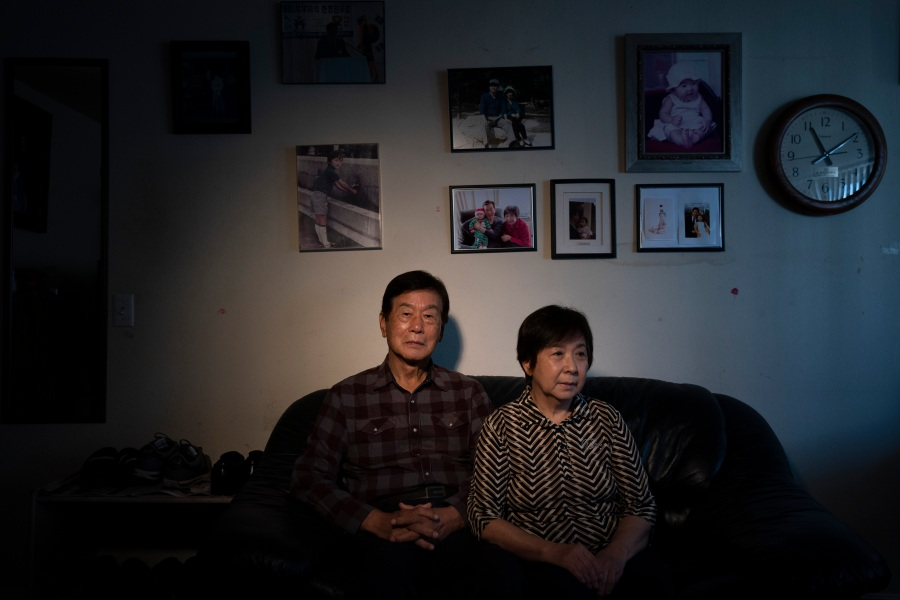 "Hyung Oh Kim, an 85-year-old immigrant from South Korea, and wife, Ki Sook, 77, pause for photos in their apartment in the Koreatown neighborhood of Los Angeles on March 24, 2021. As a head of LA Senior Citizens Society, Kim said he urges its members to carry whistles or walking sticks when leaving home for self-protection against potential random attacks. Amid the surge of anti-Asian hate crimes, Kim, who came to the States in 1989 with his wife and children, asks himself whether he made the right decision these days. ""I never had this type of fear before,"" said Kim. (Associated Press / Jae C. Hong)"