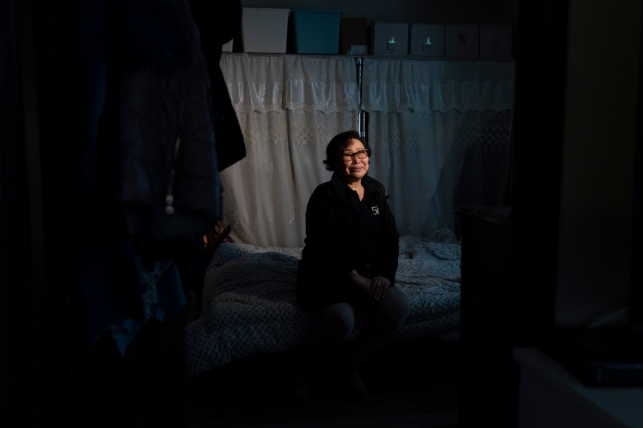Hyang Ran Kim, a 74-year-old immigrant from South Korea, pauses for photos in her apartment in downtown Los Angeles on March 25, 2021. Kim temporarily moved into her daughter's place in a quiet neighborhood in the suburbs of Orange County. Kim said her daughter was too worried about her safety amid the surge in anti-Asian hate crimes. (Jae C. Hong / Associated Press)