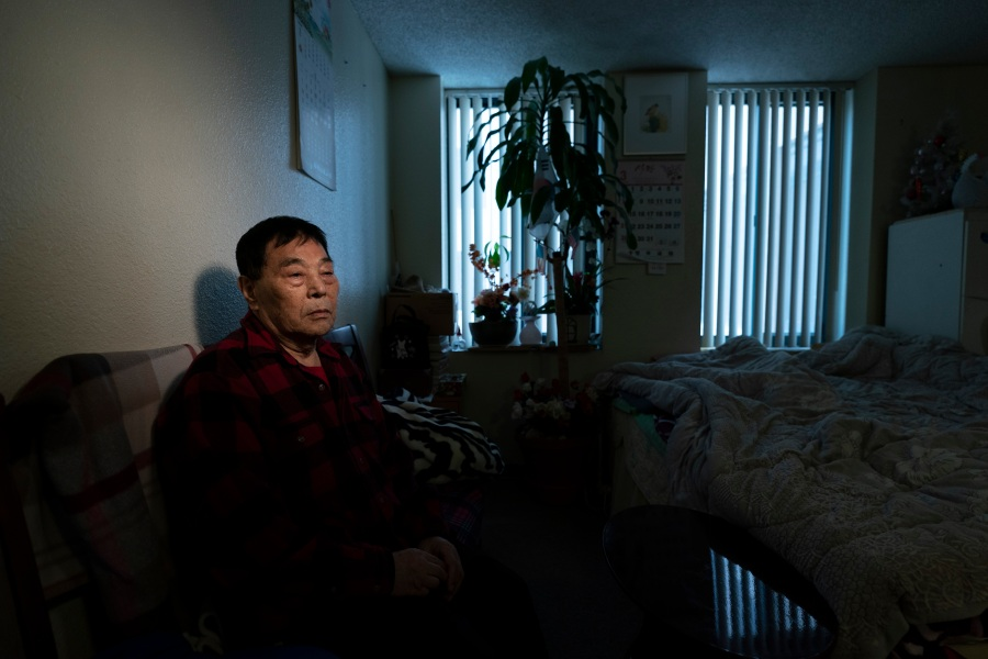 "Yong Sin Kim, an 85-year-old Korean immigrant, pauses for photos in his apartment in downtown Los Angeles on March 25, 2021. Kim said he rarely leaves home these days. When he does, he carries a whistle with him, his only defense against random attacks targeting the defenseless. ""We don't go out at all. We stay home all day as if we are locked up,"" said Kim. ""I can't even think of going for a walk."" (Jae C. Hong / Associated Press)"