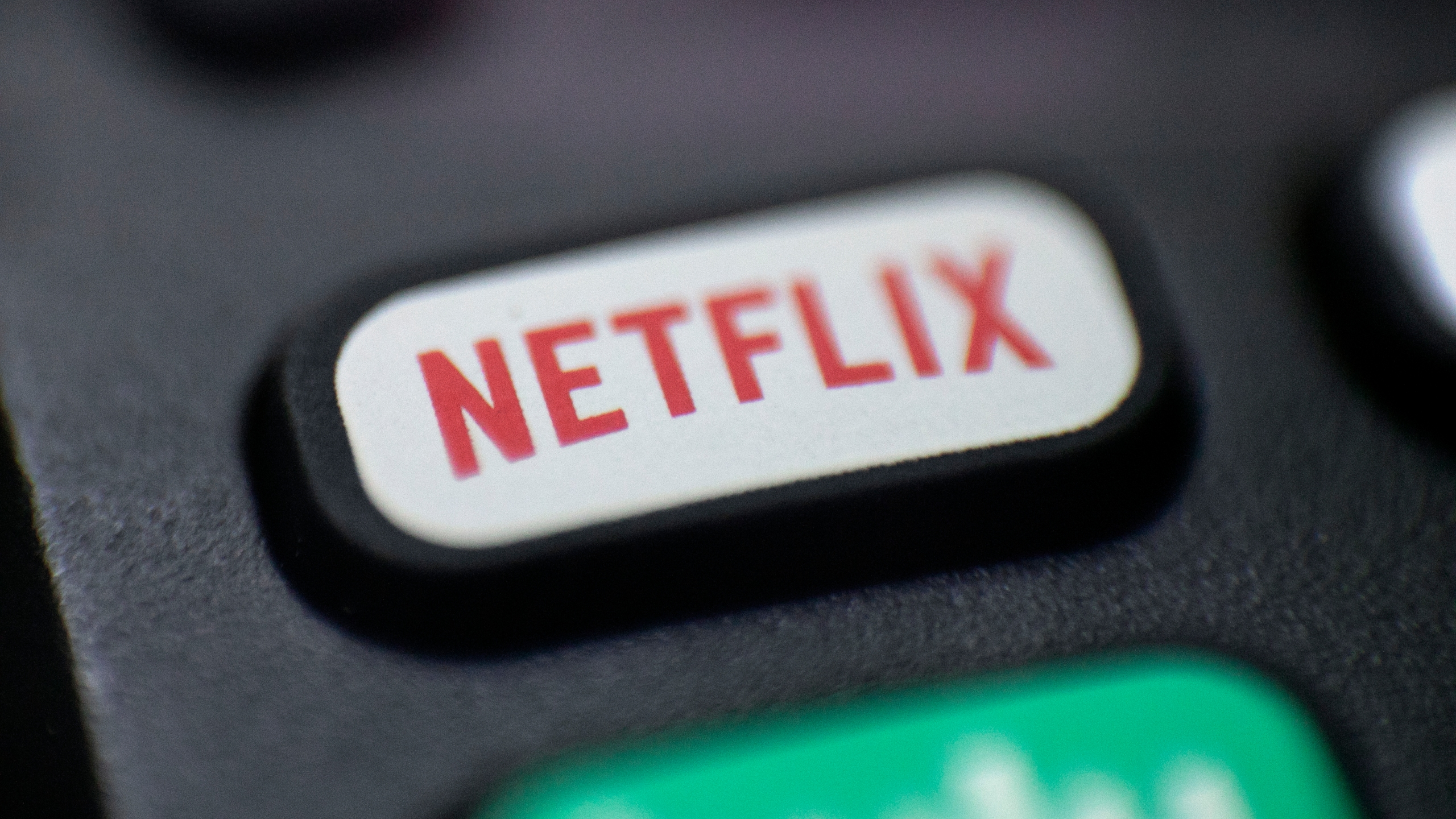FILE - This Aug. 13, 2020 photo shows a logo for Netflix on a remote control in Portland, Ore. Netflix's rapid subscriber growth is slowing far faster than anticipated, Tuesday, April 20, 2021, as people who have been cooped at home during the pandemic are able to get out and do other things again. The video streaming service added 4 million more worldwide subscribers from January through March, its smallest gain during that three-month period in four years. (AP Photo/Jenny Kane, File)