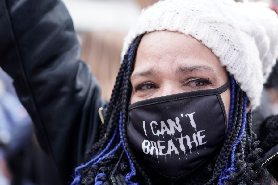 People cheer in Minneapolis after a guilty verdict was announced at the trial of former Minneapolis police Officer Derek Chauvin for the 2020 death of George Floyd on April 20, 2021. (Morry Gash / Associated Press)