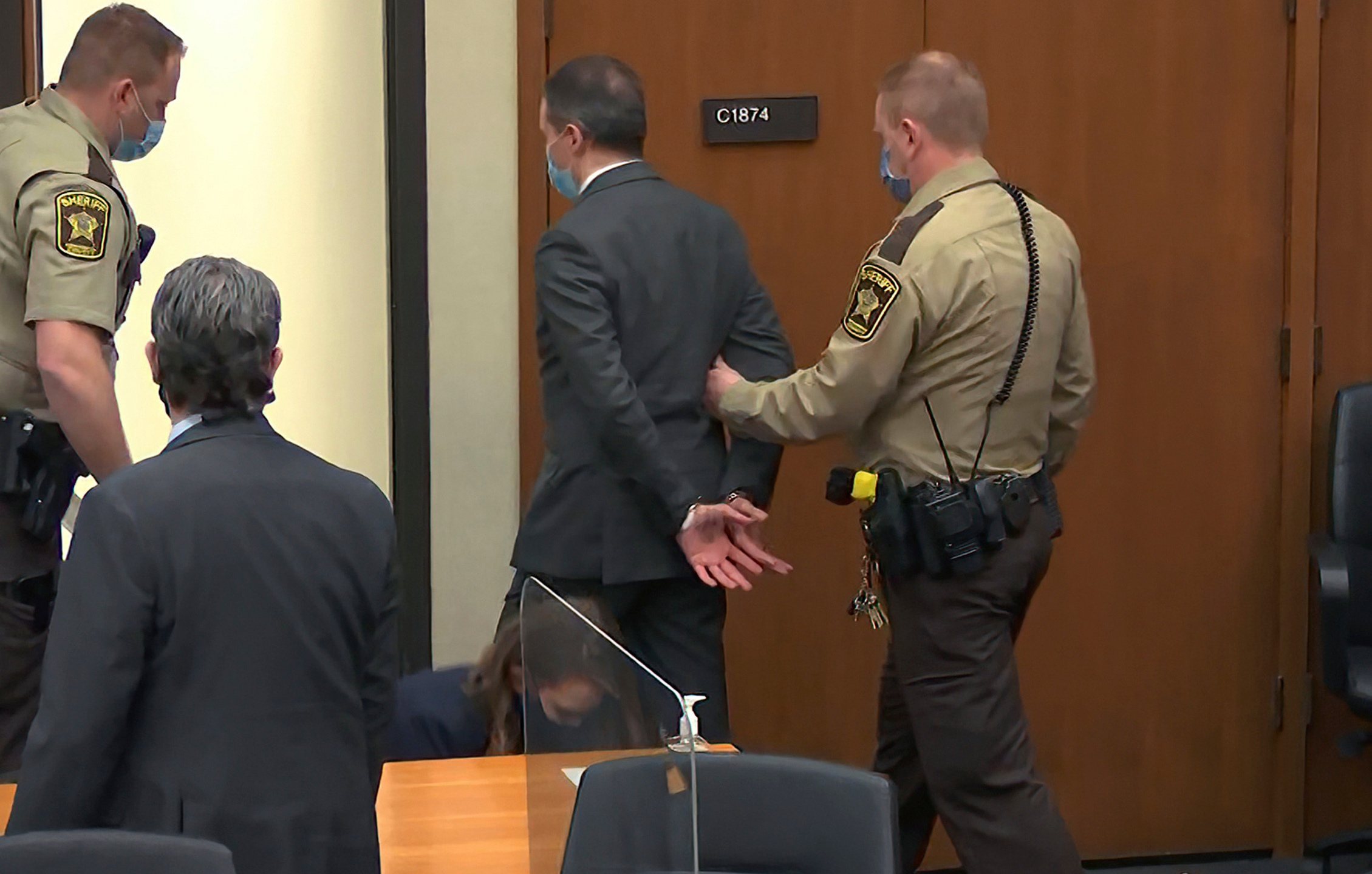 In this image from video, former Minneapolis police officer Derek Chauvin is taken into custody as his attorney Eric Nelson, left, watches, after his bail was revoked after he was found guilty on all three counts in his trial for the 2020 death of George Floyd, Tuesday, April 20, 2021, at the Hennepin County Courthouse in Minneapolis.(Court TV via AP, Pool)