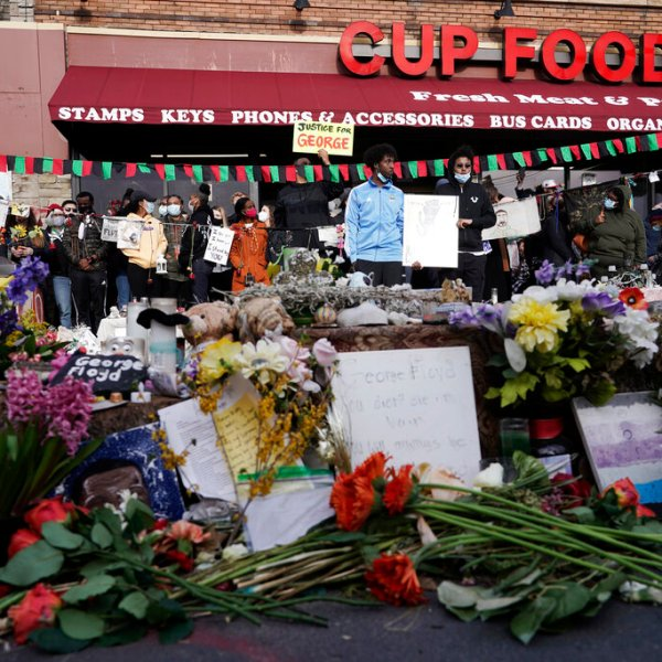 People gather at Cup Foods after a guilty verdict was announced at the trial of former Minneapolis police Officer Derek Chauvin for the 2020 death of George Floyd, Tuesday, April 20, 2021, in Minneapolis, Minn. (AP Photo/Morry Gash)