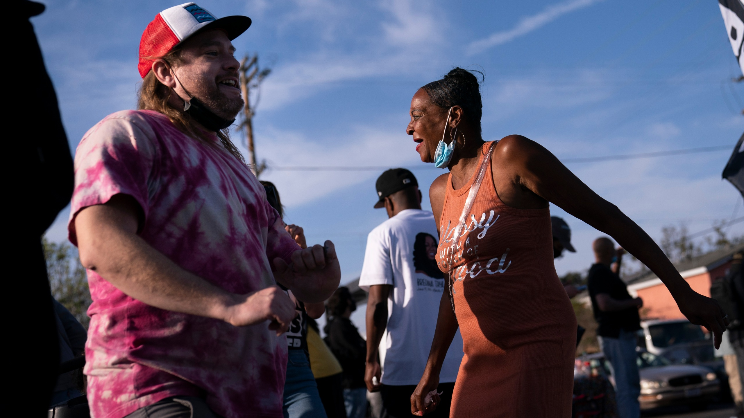 Sherri Burks, right, and Dominic Fawcett dance at the intersection of Florence and Normandie Avenues, on April 20, 2021, in Los Angeles, after a guilty verdict was announced at the trial of former Minneapolis police Officer Derek Chauvin for the 2020 death of George Floyd. (AP Photo/Jae C. Hong)