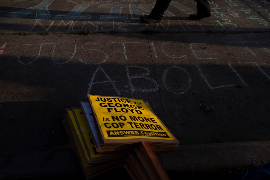 Protest signs are stacked on a sidewalk near the intersection of Florence and Normandie Avenues in Los Angeles, on April 20, 2021, after a guilty verdict was announced at the trial of former Minneapolis police Officer Derek Chauvin for the 2020 death of George Floyd. (AP Photo/Jae C. Hong)