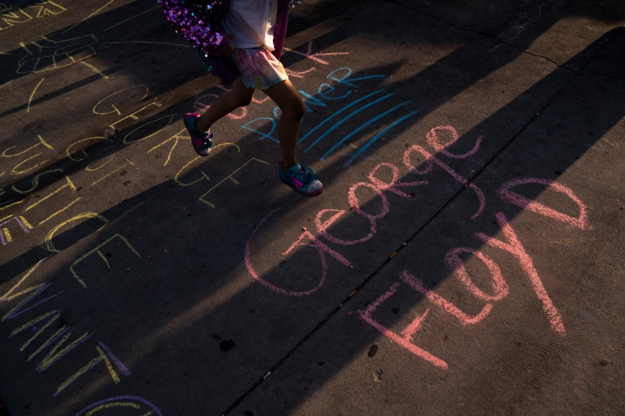 George Floyd's name is written on a sidewalk near the intersection of Florence and Normandie Avenues in Los Angeles, on April 20, 2021, after a guilty verdict was announced at the trial of former Minneapolis police Officer Derek Chauvin for the 2020 death of George Floyd. (AP Photo/Jae C. Hong)
